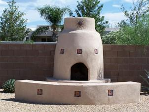 Stucco Fireplace, Block Retaining Wall, and Block Fence
